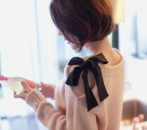 DIY Bow Embellished Sweater from Grosgrain Fabulous via Bailey Fimreite.