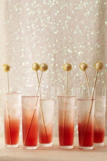 DIY Pom Pom Drink Stirrers by Martha Stewart via Candice.